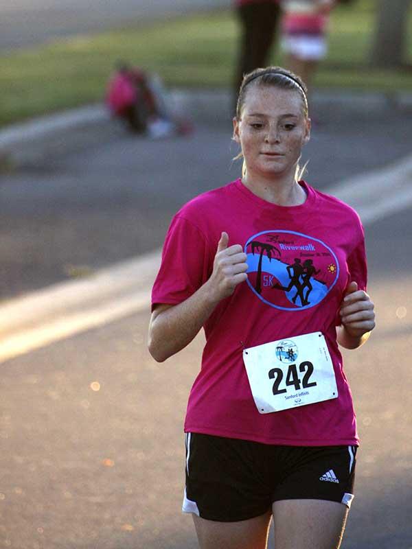 Runners crossing the finish line in the 2014 Sanford Riverwalk 5K